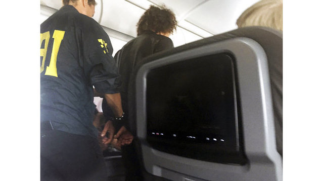 Investigators try to figure out why man disruptive on flight