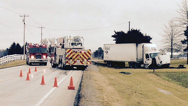 SR 14 back open after vehicle and semi collide