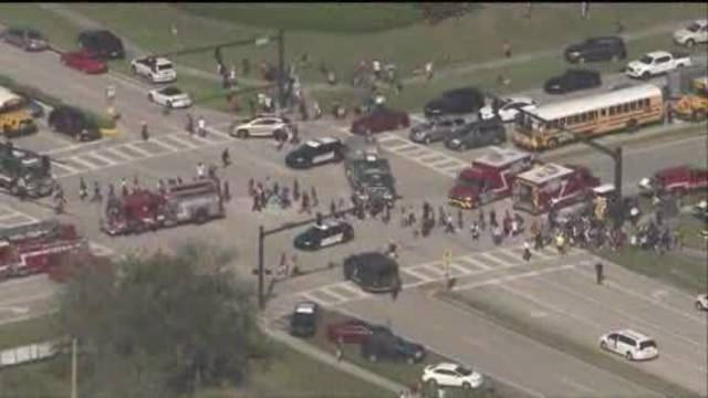 Official: 911 issues delayed response to school massacre