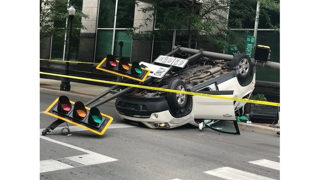 Cars crash into and take down Downtown street light